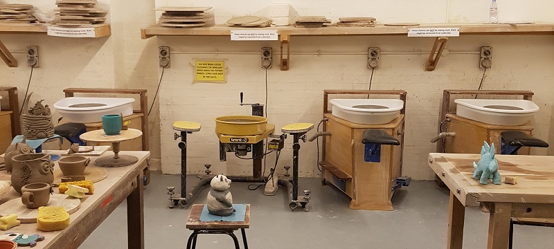 Photo of the pottery room with wheelchair accessible pottery wheel.