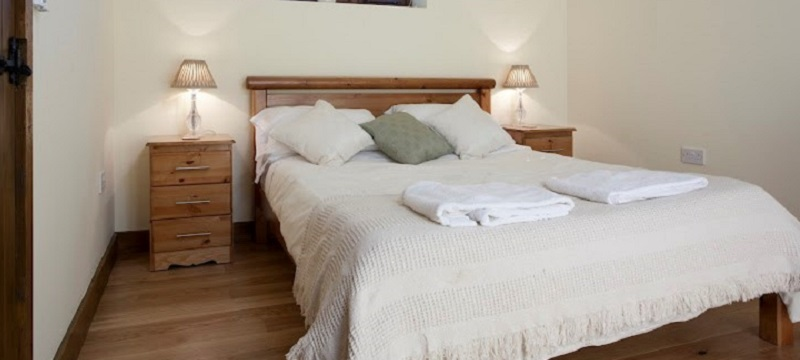 Photo of the bedroom in Iffin Farmhouse B&B.