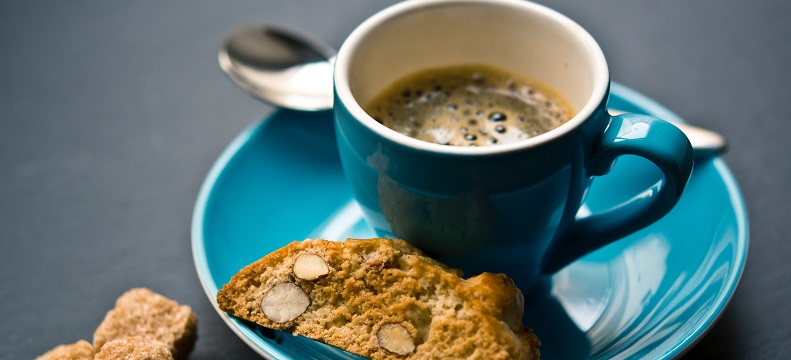 Picture of a cup of coffee and biscuits.
