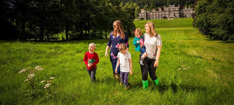 Photo of a family in the grounds of Bowhill House.