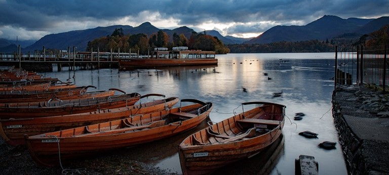 Photo of a lake and rowing boats.