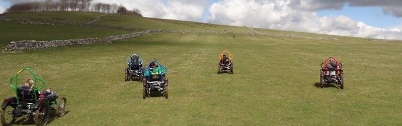 Photo of people on off road wheelchairs at Hoe Grange.