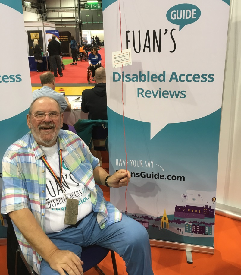 Photo of Dave volunteering with Euan's Guide at Ability Fest in Glasgow.