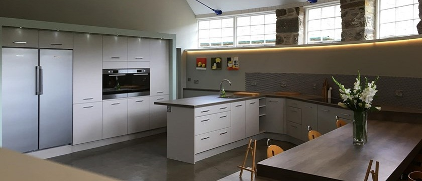 Photo of a modern kitchen in Menzies Steading.