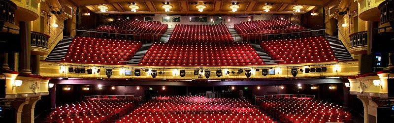 Photo of theatre seats as seen from the stage.