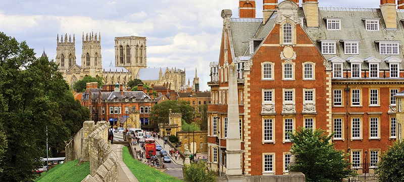 Photo of York showing the city walls and York Minster.