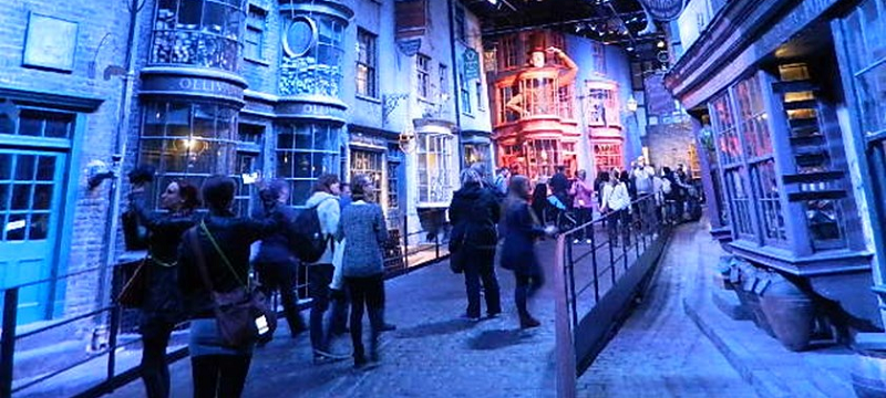 Photo of a crowd walking next to Harry Potter's Diagon Alley set in Warner Bros. studio.