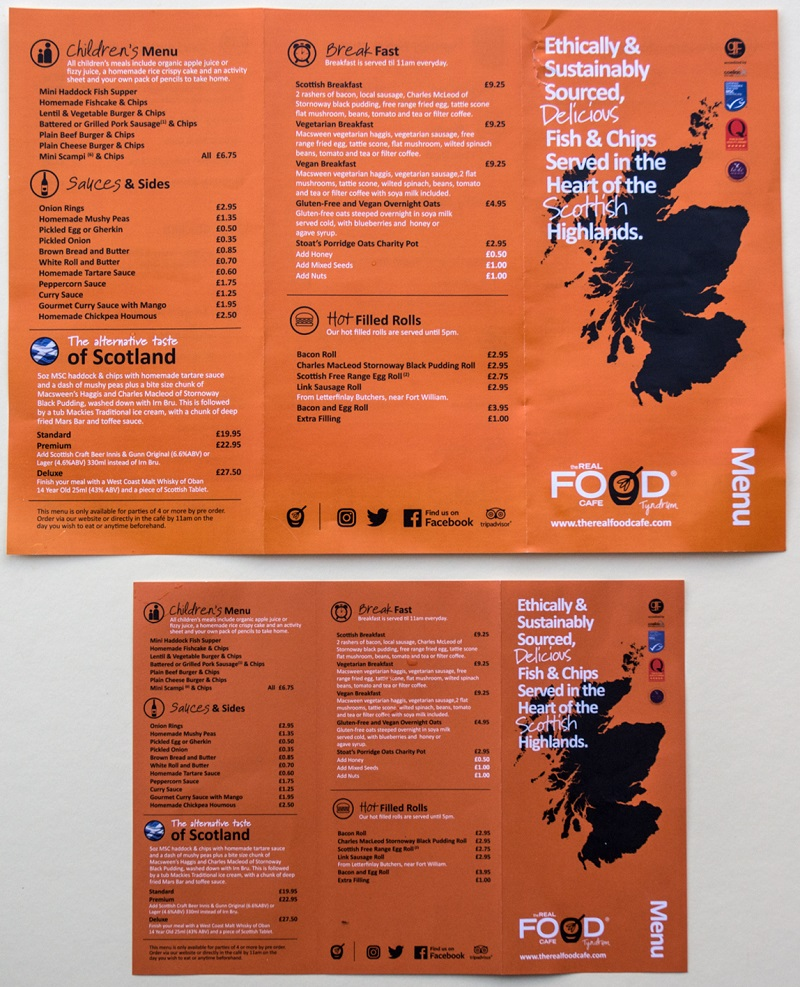 Photo of the Real Food Cafe large print menu beside a standard sized menu.