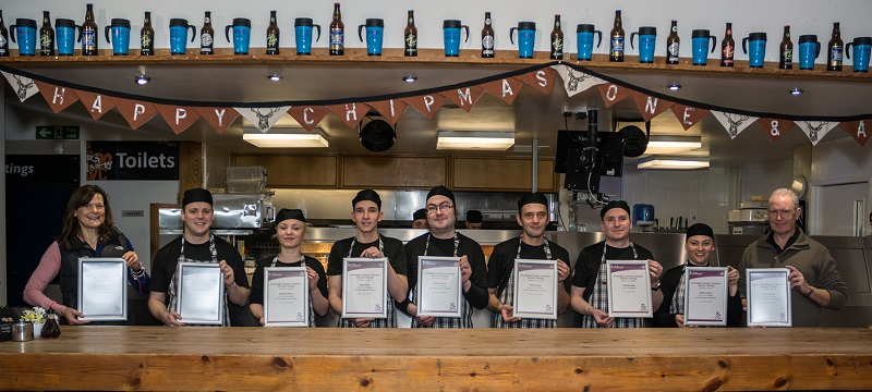 Photo of Real Food Cafe staff holding access awareness certificates.