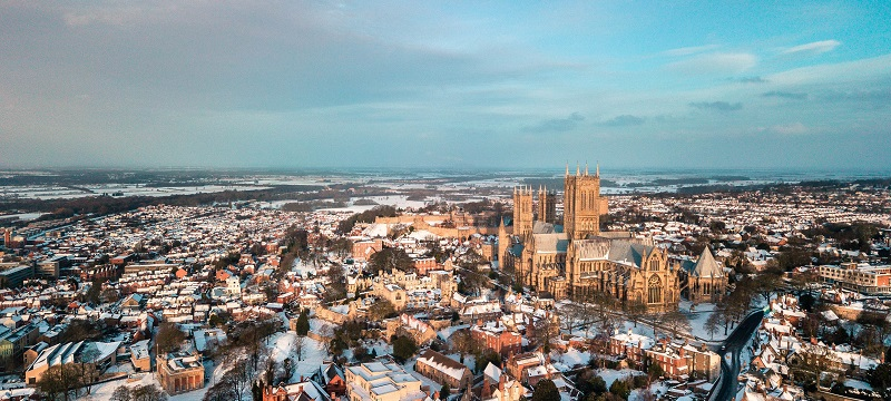 Bird's eye view of a snowy Lincoln city and cathedral.
