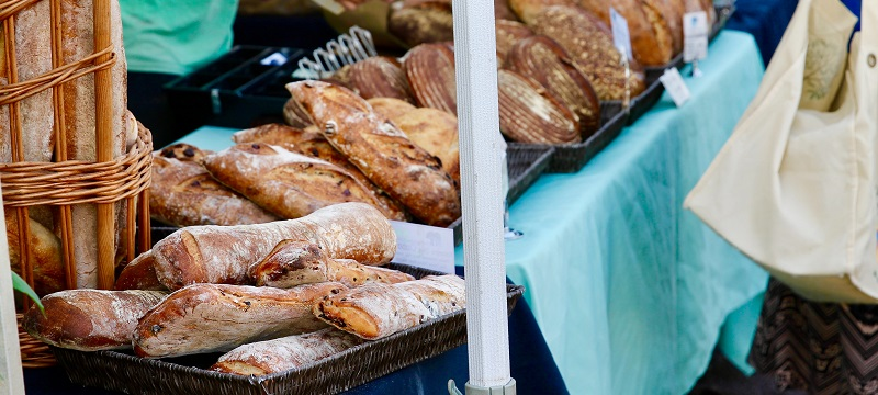 Close up of bread stall in a market.