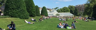 Photo of people relaxing in a park.