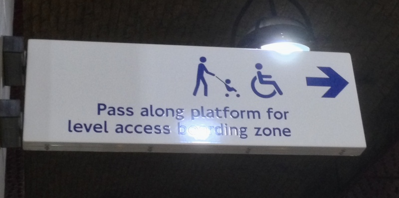 A photo of a sign on the London Underground showing where wheelchair users should go.