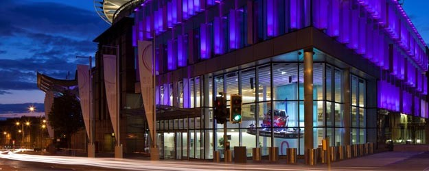 A photo of the Edinburgh International Conference Centre at night.