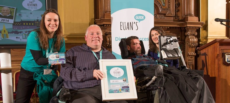 A photo of the reviewer of the year and the team at Euan's Guide.