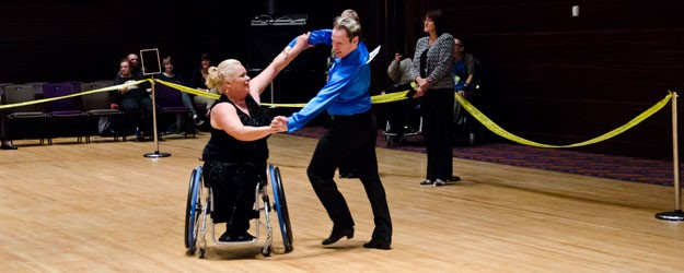 Two people dancing in a competition.