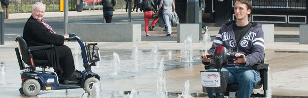 A photo of two people beside a water fountain.