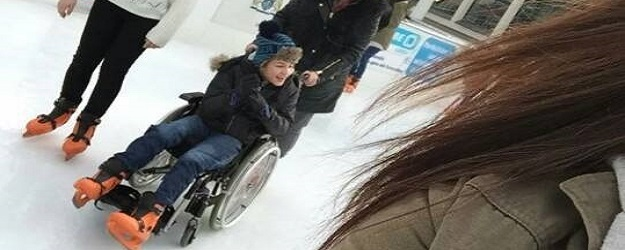 Photo of a wheelchair-user skating.