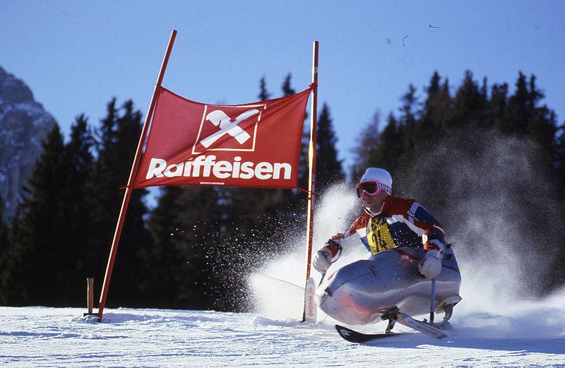 Photo of man skiing downhill.