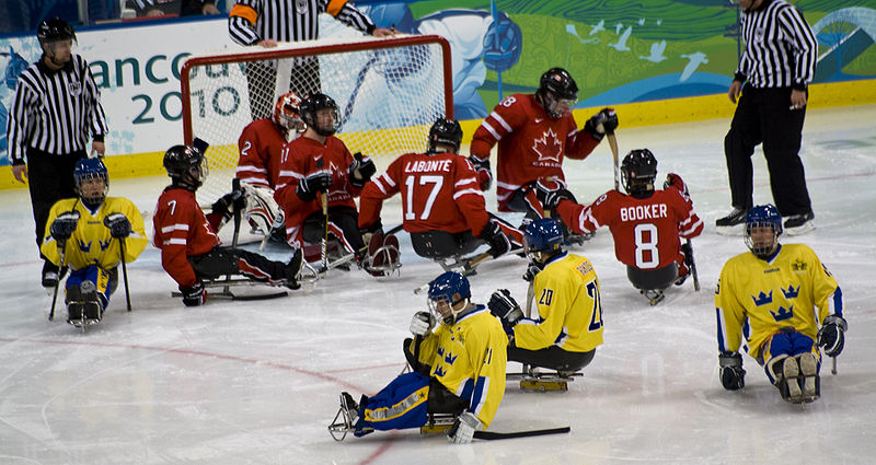 A photo of Canada against Sweden in wheelchair hockey.