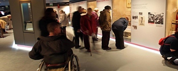 Photo of visitors to a museum.