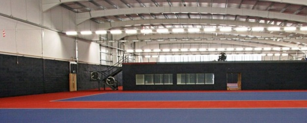 Photo of an indoor tennis court.