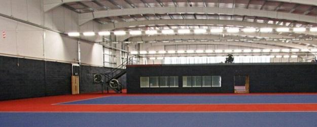 Photo of an indoor tennis court.