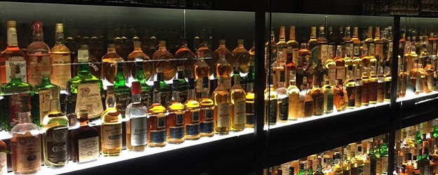 Photo of whisky bottles.