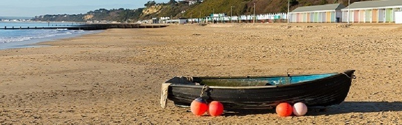 Photo of a boat on a beach.