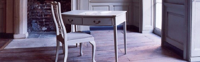 Photo of a writing desk inside an old house.