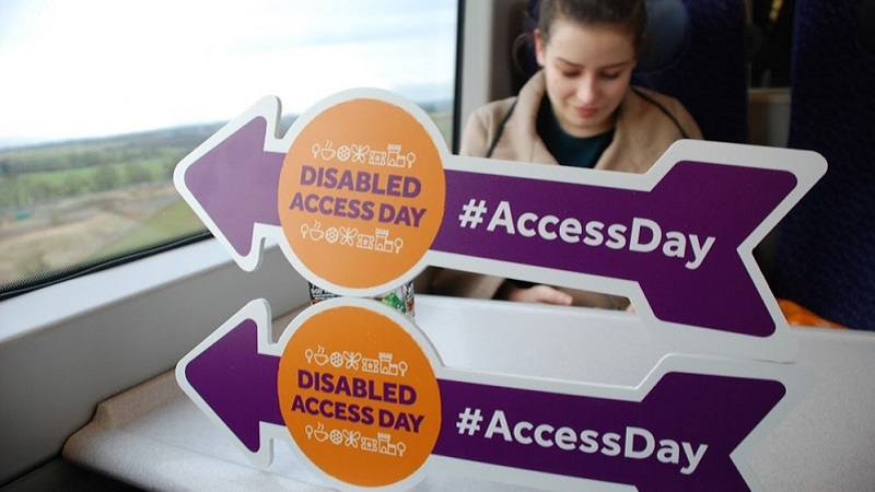 Photo of Olivia and Disabled Access Day arrows.