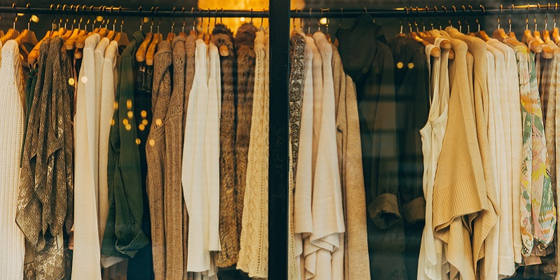 Photo of clothes in a shop window display.