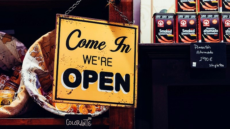 Photo of a shop open sign.
