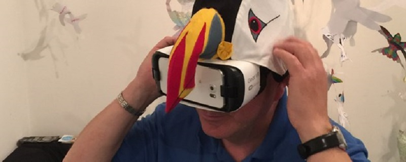 Photo of a person trying on a virtual reality headset.