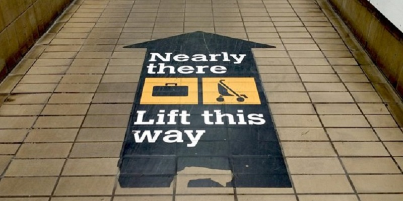 Photo of a directional floor sticker in the Tyne and Wear Metro.
