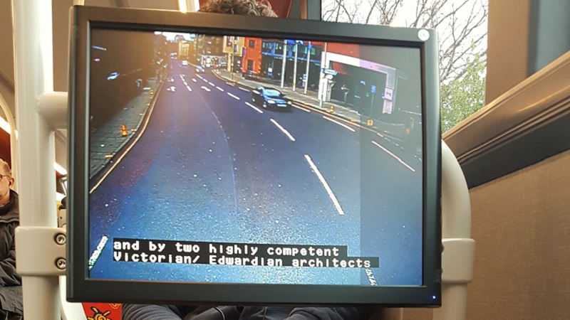 Photo of screen with subtitles.