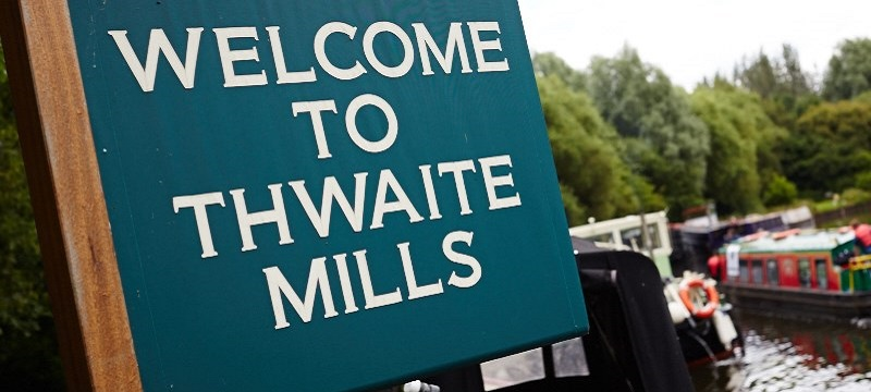 Photo of Thwaite Mills welcome sign.